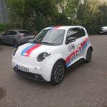 Fahrzeugbeschriftung Mainz e.Go Bosch Janssen Fahrerseite von vorne