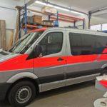 Fahrzeugbeschriftung Malteser an einem Kleintransporter
