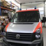 Fahrzeugbeschriftung Malteser an einem Kleintransporter von vorne